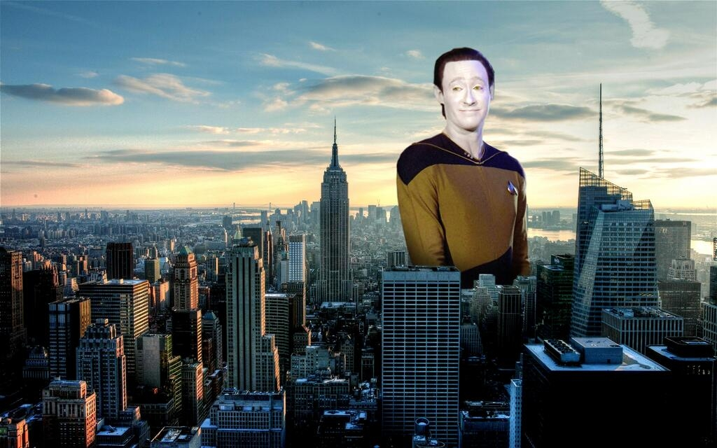 "Image of ""Data"" from Star Trek The Next Generation looming over a city skyline"